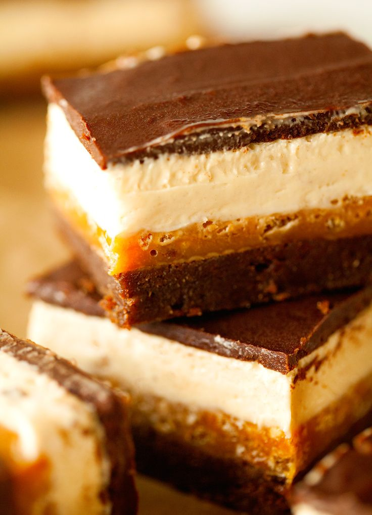 Four Layer Everything Crunch Bars - made of a fudgy brownie layer, crunchy caramel, nougat and decadent chocolate. They are so good!