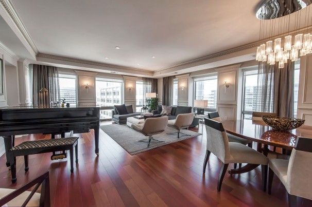 The living room of this Arlington penthouse showcases the Brazilian cherry hardwood floors throughout the apartment. The 2,370-square-foot dwelling, with its spacious layout, tray ceilings, crown molding and chair rails, doesn\'t feel like an apartment.The three-bedroom, four-bath condo is listed at $2.289 million.