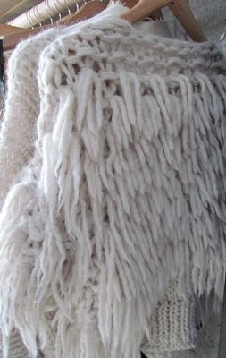 I've really been liking furry textured knits lately. I wonder if I could modify a regular sweater by using some wool and a rug hooker #knit #sweater #texture