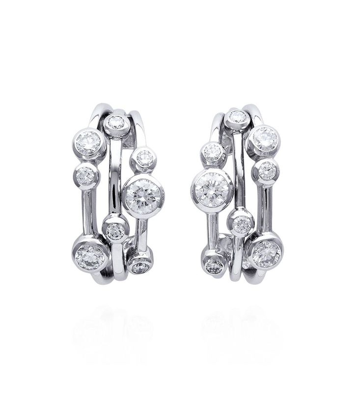 A charming hoop set of earrings from the Boodles Raindance collection. Set with round-brilliant cut diamonds. Click here to buy online or visit in store.