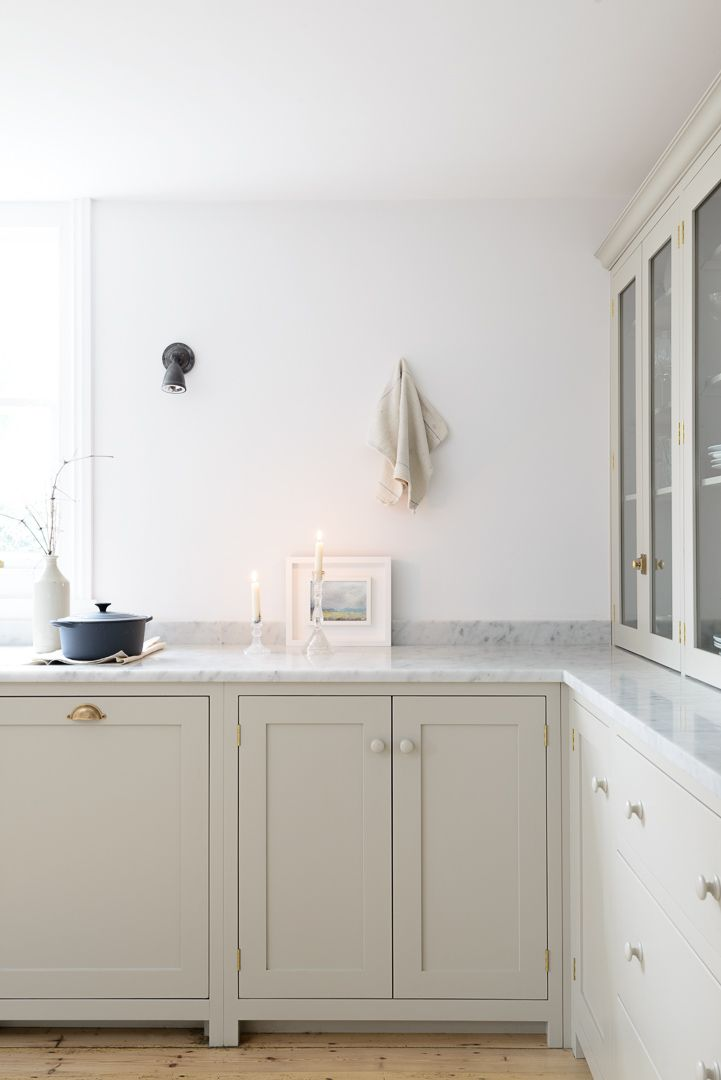 countertop cupboards and honed Carrara marble in deVOL's Brighton Shaker Kitchen