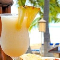 Easy recipe for pina colada cocktail made from fresh pineapples, rum and coconut. Perfect summer cocktail recipe that's cold and refreshing.