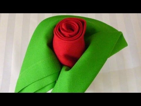How to fold your napkins so they look like a rose in bud. (Tip: Use pale shades for the rose and leaves for a more pastel look than shown here).