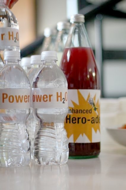 easy superhero party. ask your friends to come as a made up hero, slap some labels on drink bottles and make a cake. Simple and fabulous! http://bit.ly/HkOI3m