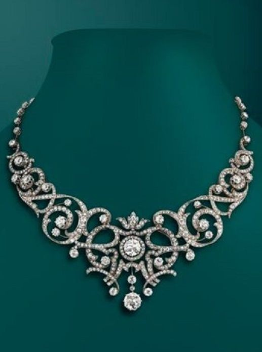 A Belle Époque diamond tiara converting to a necklace, centring two larger circular transitional-cut diamonds. The foliate scrolling openwork gold and silver mount set overall with graduated circular-cut diamonds. With gold knife edge back section set with circular-cut diamonds to each joint. With French assay mark and unidentified maker's mark 'GR'. #BelleEpoque #tiara #necklace