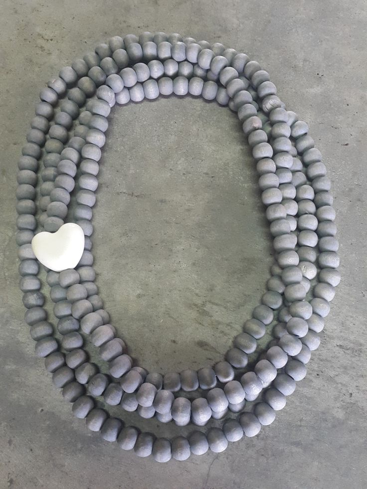 Necklace with grey wooden beads and small white heart