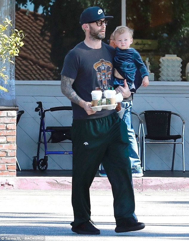 Adam Levine grabs two coffees with his daughter Dusty Rose She obviously has a caffeine craving and it seems only one brand will do. Adam Levine was seen with his 17-month-old daughter Dusty Rose grabbing two Starbucks coffees to go in Beverly Hills on Sunday morning. One was probably for his beautiful wife Victorias Secret model Behati Prinsloo who was likely at home with their newborn Gio Grace. Precious cargo: Adam Levine carried his cute daughter Dusty Rose and two Starbucks coffees to g