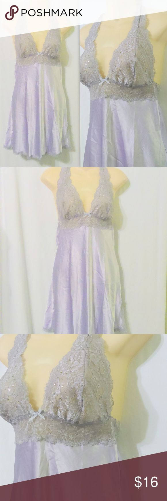 "VICTORIAS SECRET Lavender Satin Lace Nightgown This sexy little nightie is made by Victoria's Secret and is a size petite small. It is done in a lavender polyester satin with a lace bodice that has sparkling details and a racer back. Measurements are: Bust 34"", waist 30"", hips 40"", length 34"". In beautiful condition and oh so soft! Victoria's Secret Intimates & Sleepwear Chemises & Slips"
