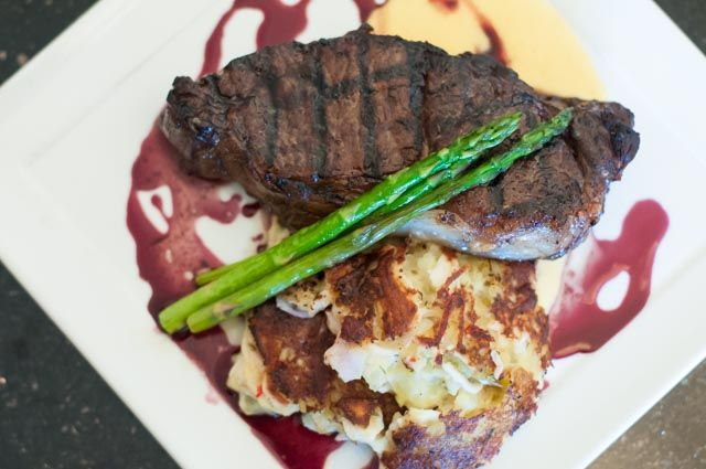 NEW YORK STRIP • 35.5 A 12 oz. strip steak served Oscar style with a house-made herb crab potato cake, grilled asparagus, hollandaise sauce, and a 7 Deadly Zins Zinfandel reduction