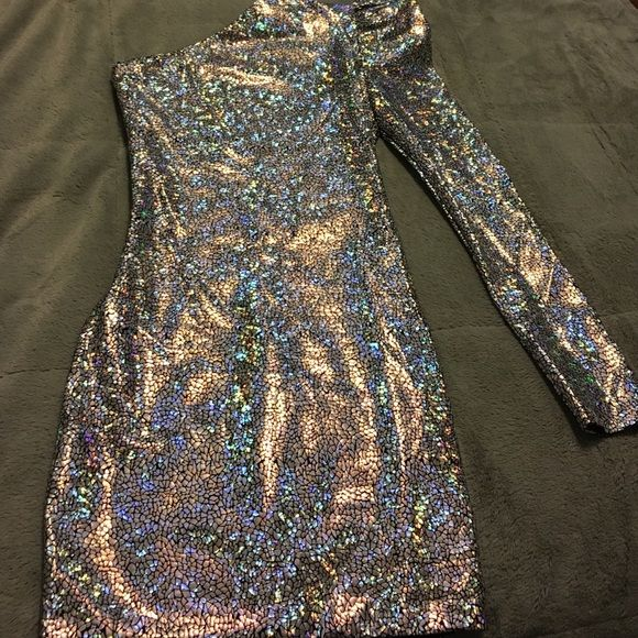 Metallic mini dress Could be worn to prom, homecoming, Or any party. Beautiful dress with one sleeve and a padded shoulder. Worn once. Dresses Prom