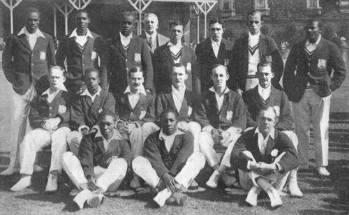 West Indies in British Isles Team photograph 1923 Back row (L-R):- JA Small (Trinidad), V Pascall (Trinidad), JK Holt (Jamaica), RH Mallett (Manager), RL Phillips (Jamaica), MP Fernandes (Demerara, Guyana), CV Hunter, (Demerara, Guyana), G John (Trinidad) Middle row:- GA Dewhurst (Trinidad), CR Browne (Demerara, Guyana), G Challenor (Barbados), HBG Austin (Captain) (Barbados), RK Nunes (Vice-Captain) (Jamaica), PH Tarilton (Barbados) Front row:- GN Francis (Barbados), LN Constantine jnr…