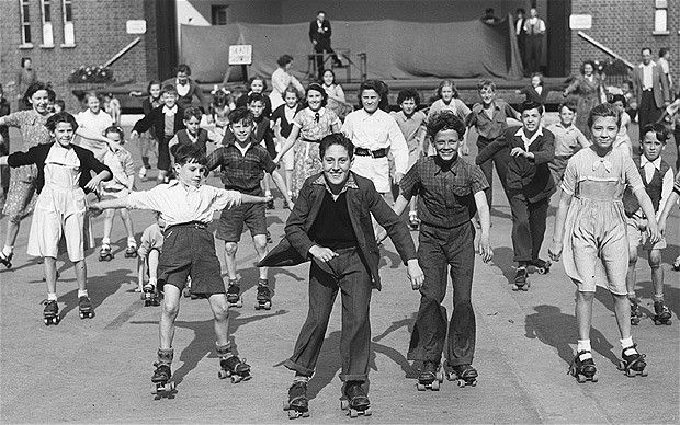 Happy Skaters, August 13, 1954 Children enjoy themselves at Victoria Park's open-air skating rink in Hackney, London.
