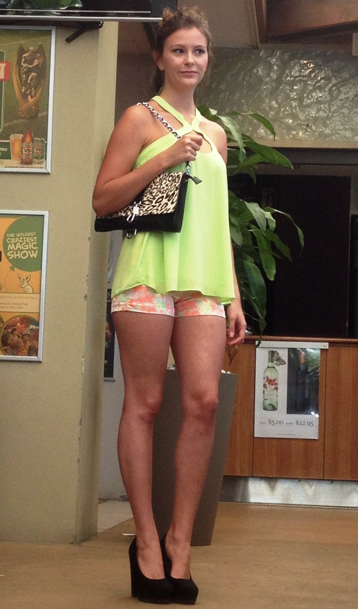 Neon delights. Shorts and top from Pure Moda teamed with an animal print bag.