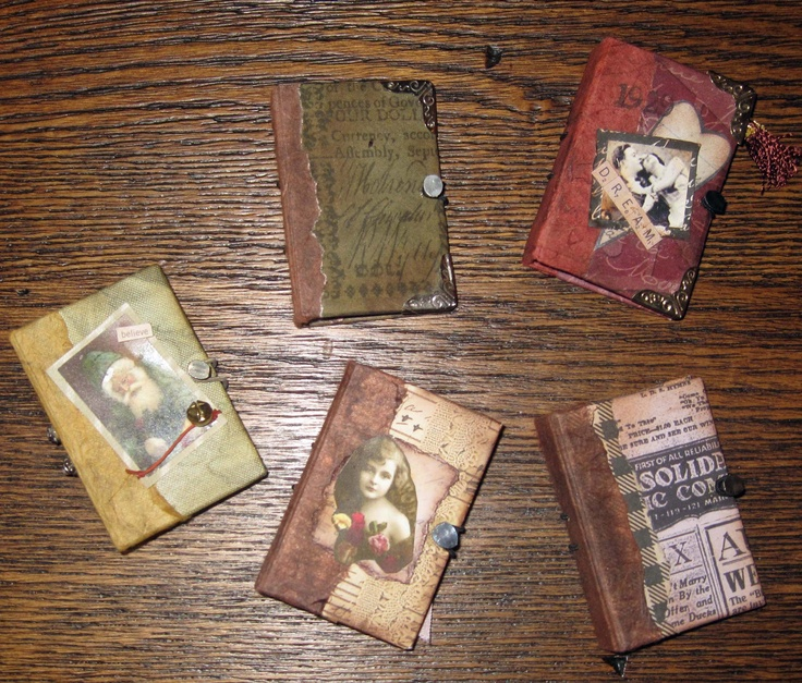 """Little Books 2 1/4"""" x 1 1/2"""" made from images, chipboard, papers, elastic band and a small nail"""