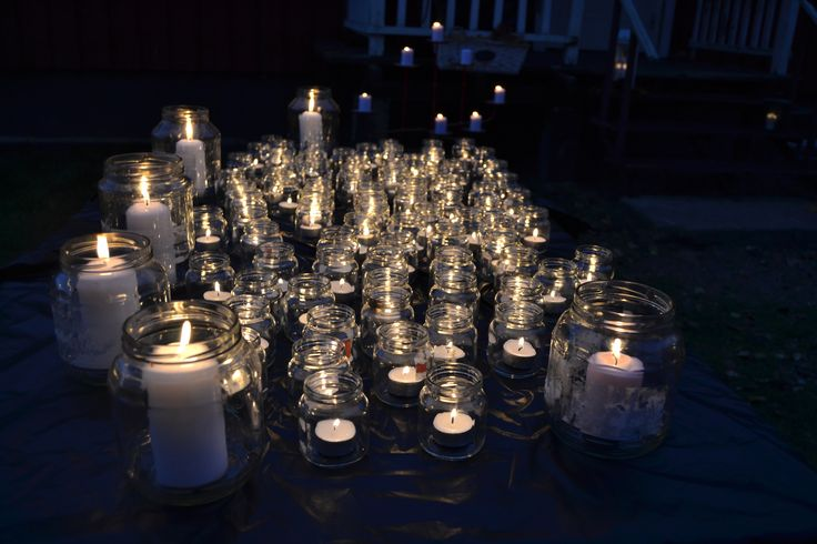 Table full of glass jar candels