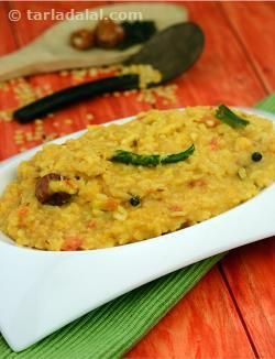 An elaborate yet easy khichdi that makes a wholesome and delicious meal, the Dal Khichdi is made of toovar dal and rice combined with not just whole spices but also onions, garlic and tomatoes. This imparts a tangy twist to the khichdi making it holistic in terms of taste too. When you don't have time to prepare a kadhi, you can just serve this with curds and papad, and there you have a sumptuous dinner on the table!
