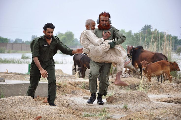 A soldier evacuating residents carries a flood victim to a helicopter in Sanawa, Pakistan's on August 5, 2010