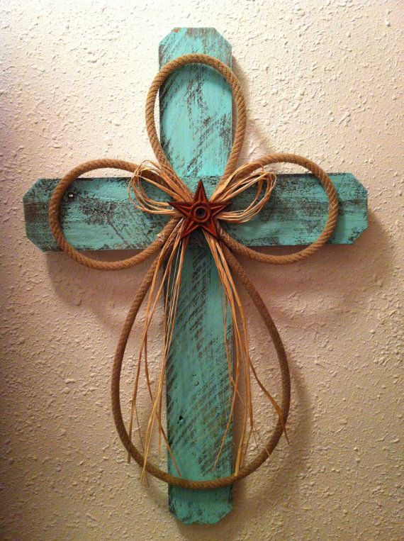 Rustic/Western Cross. Made from recycled cedar privacy fencing that has been distressed with teal paint, accented with a recycled lariat rope, a