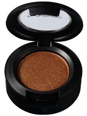 """M.A.C. Eye Shadow in Amber Lights - $15    """"WHAT IT IS:  A shimmery copper powder eye shadow    HOW IT LOOKS/FEELS:  The burnt gold powder is highly pigmented and packed with shimmer; it applies softly.    WHY WE LIKE IT:  The dramatic shade looks gorgeous on light eyes and teases out the golden flecks in hazel eyes. For a subtler look, use it as a liner."""""""