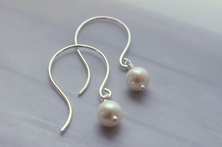A personal favorite from my Etsy shop https://www.etsy.com/listing/504898436/sterling-silver-pearl-drop-dangle-hoop