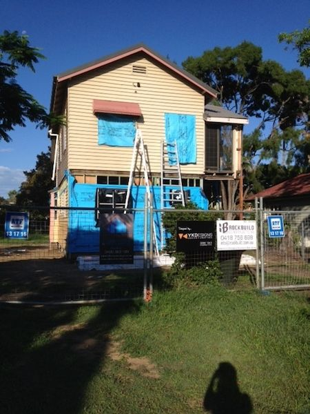 In the summer heat, as I enjoy a Northern winter, the builders toil away, wrapping the house in insulation and commence cladding the building. #insulation #renovation