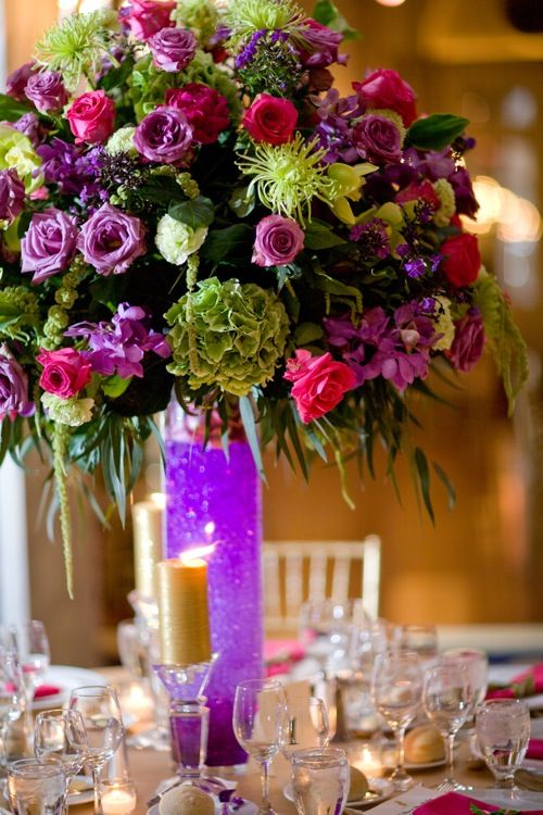 Tall Centerpiece - Our centerpieces will look similar but be smaller, in a pilsner vase, and have Gladiolus submerged in the bottom