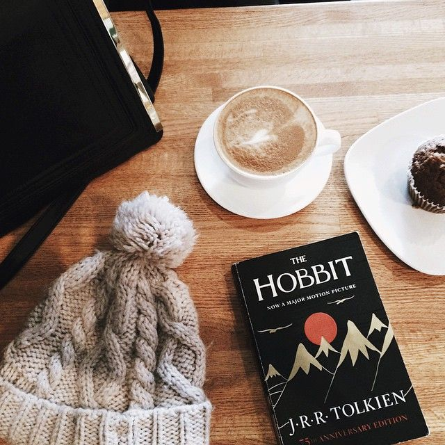 agentlewoman:  It's a whopping 12 degrees in Chicago today. Warming up with a good book and treats (at The Coffee Studio)