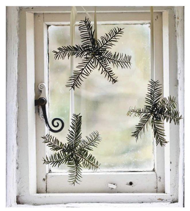 pine bough snowflakes in the window