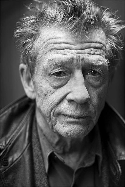 John Hurt.  This man is a genius of an actor, and always lifts my spirits when I look at this picture.  You don't have to look happy to be happy.