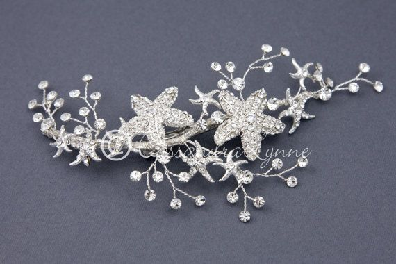 Two sparkling, rhinestone adorned starfish are surrounded by sprays of rhinestone jewels in this beach wedding hair clip.This headpiece is about 6