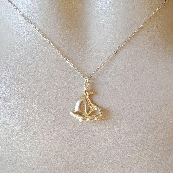 Gold Ship Necklace - Ship Jewelry - Ship Necklace - Nautical Jewelry - Nautical Jewellery - Gold Necklace - Mothers Day Gift - Weddings - Bridal - Bridesmaid Gifts - Graduation Present - Christmas Gift    This is a Gold Filled and Matte Gold Plated Brass Ship Necklace created with the following Materials    *15mm x 18mm Matte Gold Plated Brass Ship Pendant*  *Gold Filled Chain*  *Gold Filled Findings*  *Gold Filled Spring Ring Clasp*    It's 12 inches long and can be adjusted to your…