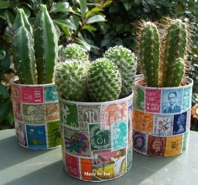 cans decoupaged with stamps and planted with succulents