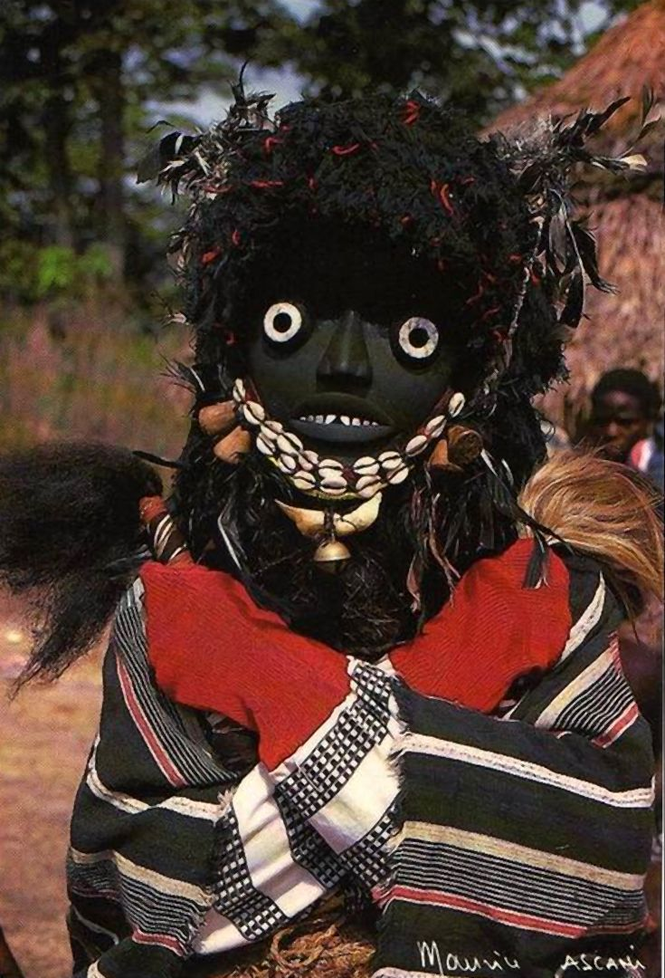 Africa | Masquerader.  Banye Village, Ivory Coast || Postcard; publisher Phocal Abidjan, photographer Maurice Ascani