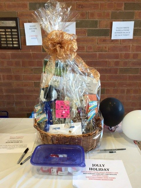 """Basket Raffle The Raffle Baskets are an important part of the fundraising activities that support the production of """"Mary Poppins""""."""