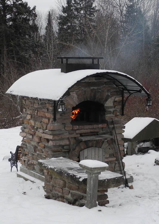 Forno Bravo oven in Ottawa Valley...Like the stacked stone look and the arched tin roof