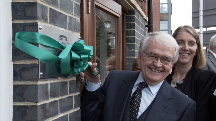 """Our latest film in the series """"Glad to be in Chorlton"""" celebrating the redevelopment of Cosgrove Hall film studios into Cosgrove Hall Court. Brian Cosgrove cuts the ribbon over a plaque commemorating the studio which has now been developed by McCarthy and Stone into retirement apartments."""