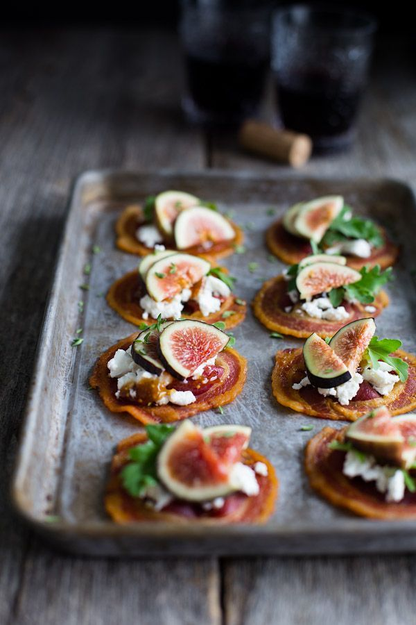 Pancetta Crisps with Goat Cheese and Figs - crispy rounds of pancetta get topped with creamy goat cheese, fig jam, and fresh figs.