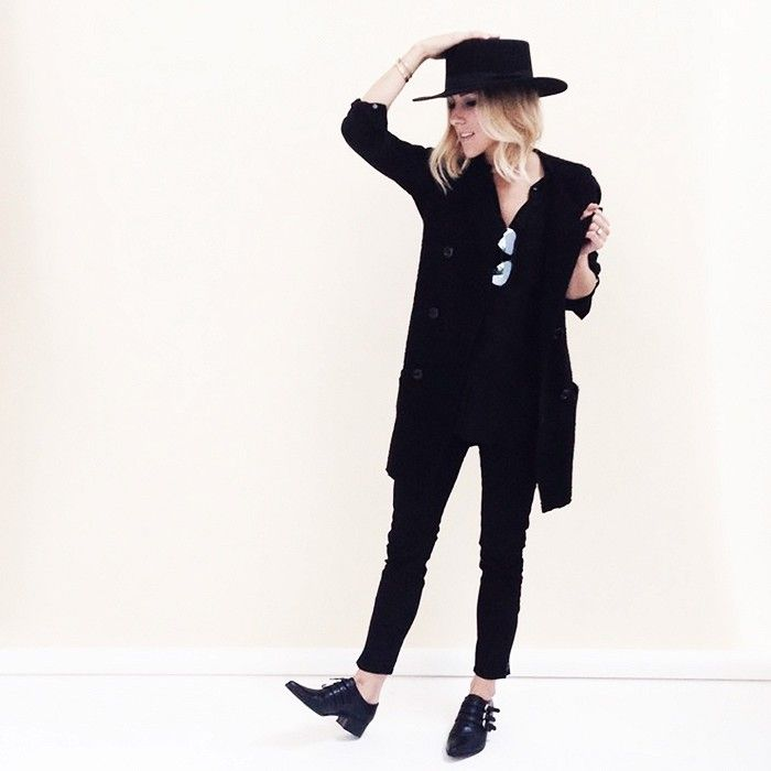 Damsel in Dior sticks with black tones, but wears sharp accessories like a wide brim hat and pointy flats.