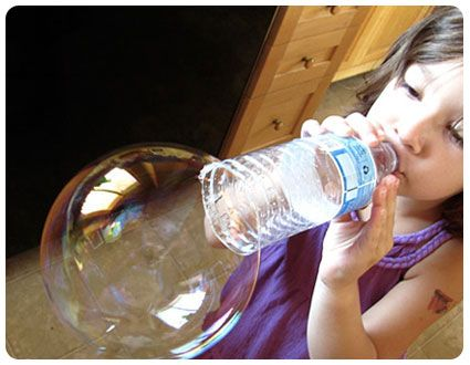 Make bubbles and wand with items you have at home! Homemade bubble recipe using water, corn syrup, and liquid dish soap. Combine with an empty water bottle = tons of big bubble fun!