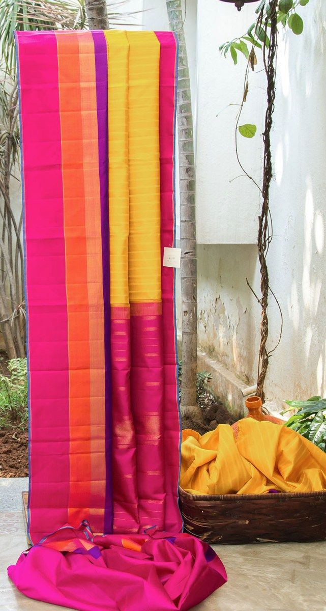 ALLURING YELLOW HAS COMPLIMENTING STRIKING DARK PINK, ORANGE AND VIOLET TEMPLE BORDER. THE DARK PINK WITH GOLD ZARI PALLU ADD BEAUTY TO THIS SAREE.