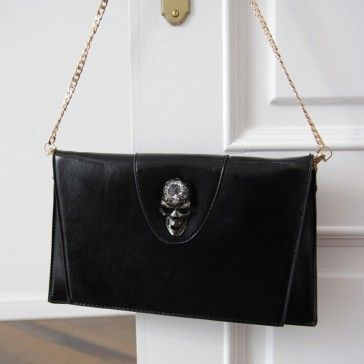 [Skull Clutch: Black] A faux #leather #clutch featuring a #skull accent. Chain strap. Optional wristlet strap. Foldover top with a hidden magnetic snap closure. Exterior zip pocket. #bags #gdragon #gd #kpop #accessories #kpop #korean #asianfashion