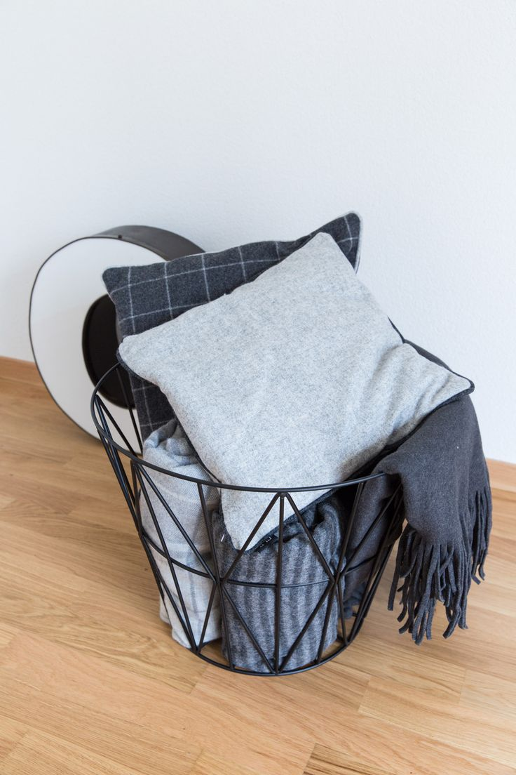ferm living wire basket filled with throws and pillows // 70percentpure x ezisliving