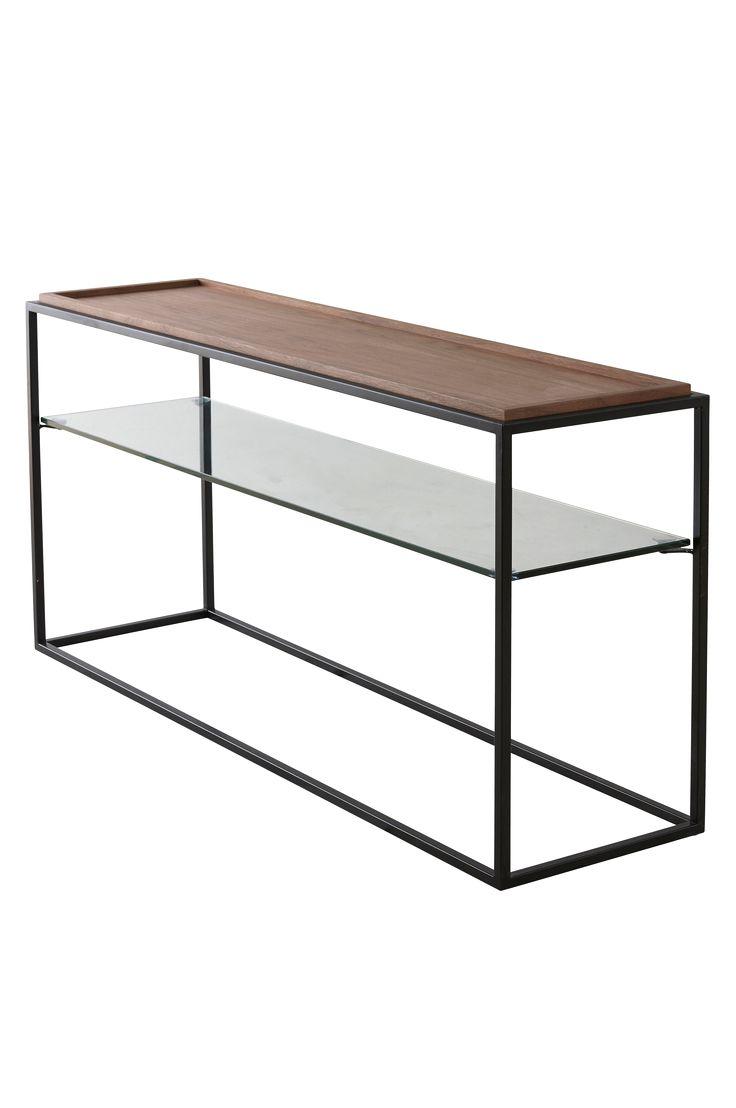 Modernt sidobord i mörk mdf-faner med detaljer som upphöjd kantlist samt glasskiva. Passar lika bra i en hall som ett vardagsrum. Material: Mdf, glas och metall. Storlek: Höjd 60 cm, längd 120 cm, bredd 33 cm. Beskrivning: Avlångt sidobord med fanerad mdf-skiva och hylla av klarglas. Skötselråd: Torkas med fuktig trasa. Tips/råd: Matcha med soffbordet OXBERG för att få igenom stilen i fler möbler.