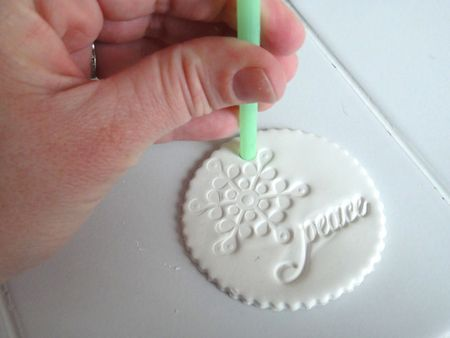 sculpey ornament -- try with cornstarch clay -- straw for hole!