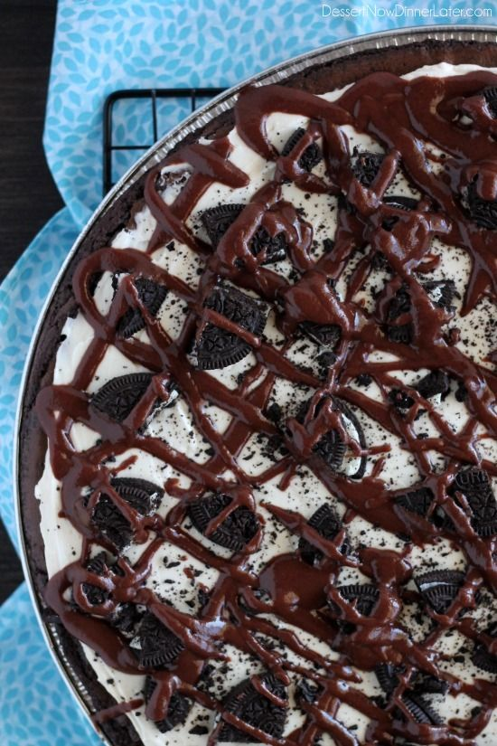 Oreo Fudge Brownie Pizza – These brownies are for the Oreo lovers! There are plenty of Oreo's inside and out of this dessert pizza, topped with a marshmallow fluff frosting and drizzled in fudge sauce. From DessertNowDinnerLater.com