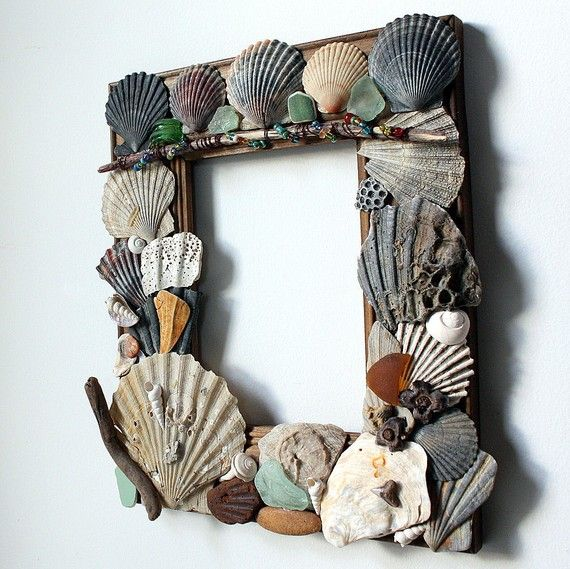 Shell, sea glass, fossil, and driftwood frame I created. In my easy shop.