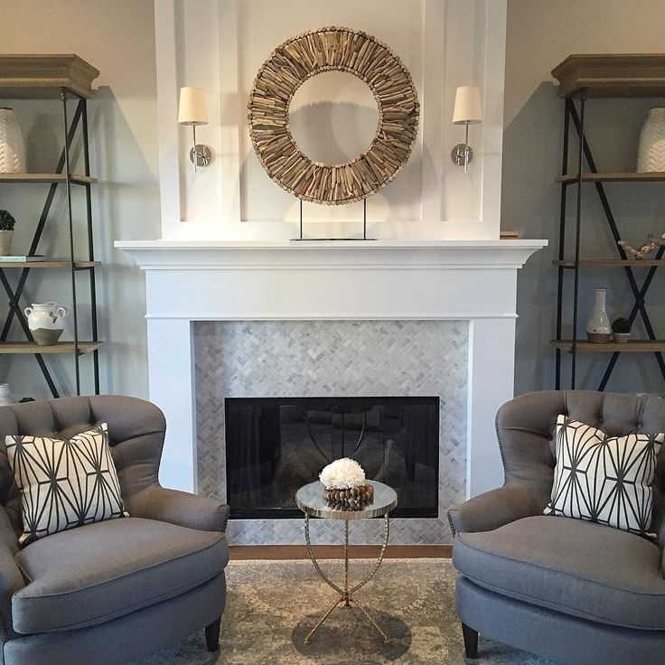 Restoration Hardware bookshelves and Pottery Barn chairs.