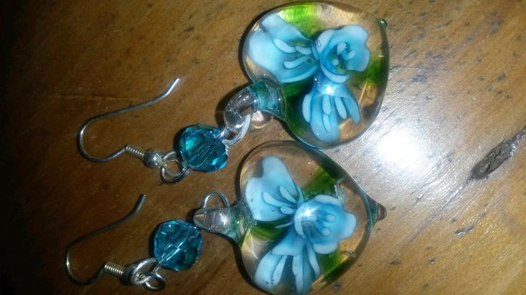 Gorgeous glass earrings - pale blue flower inner.