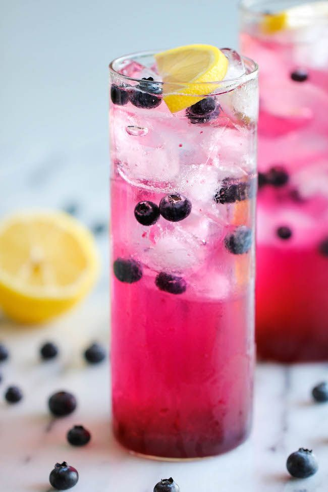 Blueberry Lemonade - Made with an easy blueberry syrup, this lemonade is so refreshing, sweet and tangy! It's the perfect way to cool down on a hot day!