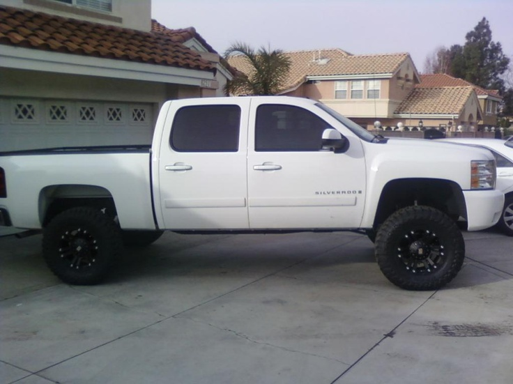 jacked up white chevy trucks - photo #14